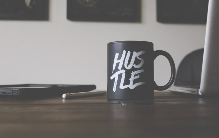 Mug with Hustle written on side
